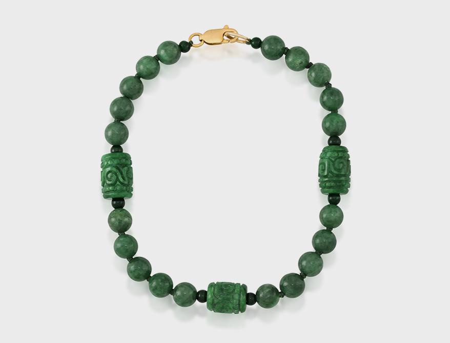 Mason-Kay Jade  Jadeite jade bead bracelet with 14K yellow gold clasp.