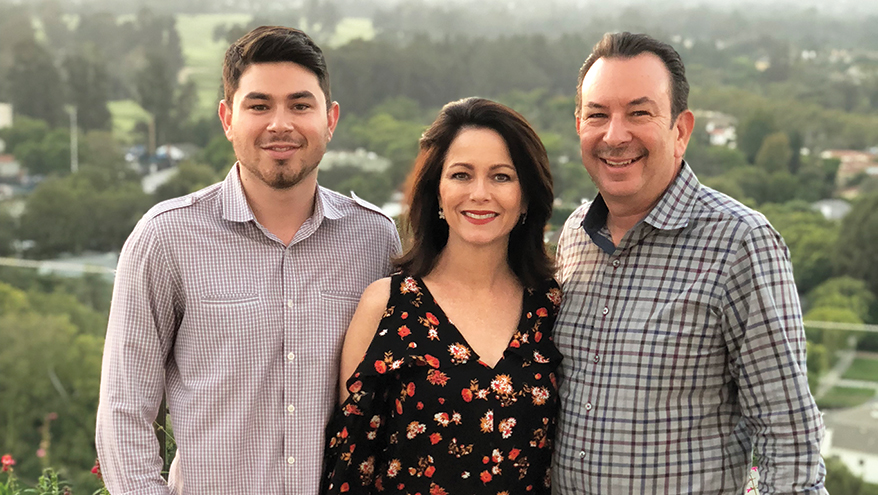 Brandon Heller, left, son of company founders Scott and Catherine Heller, developed an interest in both the family business and watches when he learned to change watch batteries.